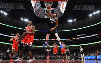 CHICAGO, ILLINOIS - NOVEMBER 18:  Giannis Antetokounmpo #34 of the Milwaukee Bucks dunks against the Chicago Bulls during the first half of a game at United Center on November 18, 2019 in Chicago, Illinois. NOTE TO USER: User expressly acknowledges and agrees that, by downloading and or using this photograph, User is consenting to the terms and conditions of the Getty Images License Agreement. (Photo by Stacy Revere/Getty Images)