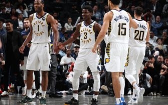 BROOKLYN, NY - NOVEMBER 18: Aaron Holiday #3 of the Indiana Pacers hi-fives teammates during the game against the Brooklyn Nets on November 18, 2019 at Barclays Center in Brooklyn, New York. NOTE TO USER: User expressly acknowledges and agrees that, by downloading and or using this photograph, User is consenting to the terms and conditions of the Getty Images License Agreement. Mandatory Copyright Notice: Copyright 2019 NBAE  (Photo by Nathaniel S. Butler/NBAE via Getty Images)