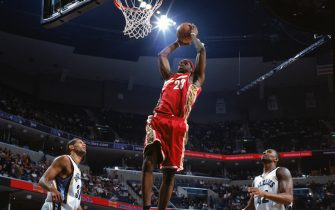 MEMPHIS - DECEMBER 13:  LeBron James #23 of the Cleveland Cavaliers makes a layup against the Memphis Grizzlies at FEDEX Forum on December 13,2004 in Memphis, Tennessee. The Cavaliers won 92-86. NOTE TO USER: User expressly acknowledges and agrees that, by downloading and/or using this Photograph, user is consenting to the terms and conditions of the Getty Images License Agreement. Mandatory Copyright Notice: Copyright 2004 NBAE (Photo by: Joe Murphy/NBAE via Getty Images) *** Local Caption *** LeBron James