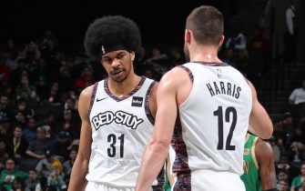 BROOKLYN, NY - NOVEMBER 29: Jarrett Allen #31 and Joe Harris #12 of the Brooklyn Nets high five against the Boston Celtics on November 29, 2019 at Barclays Center in Brooklyn, New York. NOTE TO USER: User expressly acknowledges and agrees that, by downloading and or using this photograph, User is consenting to the terms and conditions of the Getty Images License Agreement. Mandatory Copyright Notice: Copyright 2019 NBAE (Photo by Nathaniel S. Butler/NBAE via Getty Images)