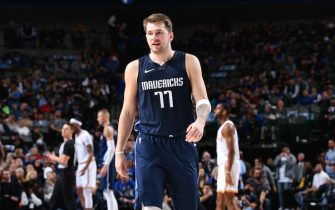 DALLAS, TX - NOVEMBER 20: Luka Doncic #77 of the Dallas Mavericks walks down the court during a game against the Golden State Warriors on November 20, 2019 at the American Airlines Center in Dallas, Texas. NOTE TO USER: User expressly acknowledges and agrees that, by downloading and or using this photograph, User is consenting to the terms and conditions of the Getty Images License Agreement. Mandatory Copyright Notice: Copyright 2019 NBAE (Photo by Glenn James/NBAE via Getty Images)