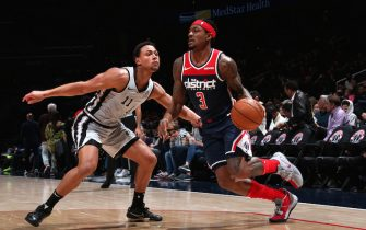WASHINGTON, DC - NOVEMBER 20:  Bradley Beal #3 of the Washington Wizards handles the ball against Bryn Forbes #11 of the San Antonio Spurs on November 20, 2019 at Capital One Arena in Washington, DC. NOTE TO USER: User expressly acknowledges and agrees that, by downloading and or using this photograph, User is consenting to the terms and conditions of the Getty Images License Agreement. (Photo by Ned Dishman/NBAE via Getty Images)