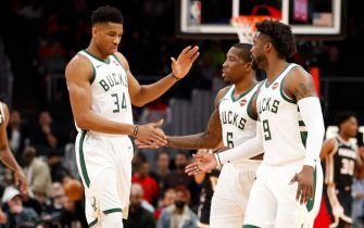 ATLANTA, GA - NOVEMBER 20: Giannis Antetokounmpo #34 of the Milwaukee Bucks reacts with teammates Eric Bledsoe #6 and Wesley Matthews #9 during the first half of an NBA game against the Atlanta Hawks at State Farm Arena on November 20, 2019 in Atlanta, Georgia. (Photo by Todd Kirkland/Getty Images) *** Local Caption *** Giannis Antetokounmpo; Eric Bledsoe; Wesley Matthews