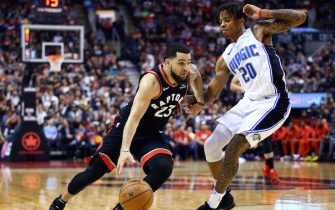 TORONTO, ON - NOVEMBER 20:  Fred VanVleet #23 of the Toronto Raptors dribbles the ball as Markelle Fultz #20 of the Orlando Magic defends during the second half of an NBA game at Scotiabank Arena on November 20, 2019 in Toronto, Canada.  NOTE TO USER: User expressly acknowledges and agrees that, by downloading and or using this photograph, User is consenting to the terms and conditions of the Getty Images License Agreement.  (Photo by Vaughn Ridley/Getty Images)