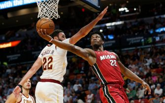 MIAMI, FLORIDA - NOVEMBER 20: Jimmy Butler #22 of the Miami Heat attempts a layup against Larry Nance Jr. #22 of the Cleveland Cavaliers during the second half at American Airlines Arena on November 20, 2019 in Miami, Florida. NOTE TO USER: User expressly acknowledges and agrees that, by downloading and/or using this photograph, user is consenting to the terms and conditions of the Getty Images License Agreement.  (Photo by Michael Reaves/Getty Images)
