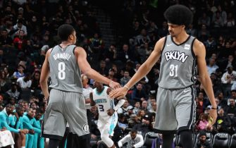 BROOKLYN, NY - NOVEMBER 20: Spencer Dinwiddie #8, and Jarrett Allen #31 of the Brooklyn Nets hi-five each other against the Charlotte Hornets on November 20, 2019 at Barclays Center in Brooklyn, New York. NOTE TO USER: User expressly acknowledges and agrees that, by downloading and or using this photograph, User is consenting to the terms and conditions of the Getty Images License Agreement. Mandatory Copyright Notice: Copyright 2019 NBAE  (Photo by Nathaniel S. Butler/NBAE via Getty Images)