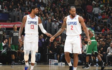 LOS ANGELES, CA - NOVEMBER 20: Paul George #13, and Kawhi Leonard #2 of the LA Clippers look on against the Boston Celtics on November 20, 2019 at STAPLES Center in Los Angeles, California. NOTE TO USER: User expressly acknowledges and agrees that, by downloading and/or using this Photograph, user is consenting to the terms and conditions of the Getty Images License Agreement. Mandatory Copyright Notice: Copyright 2019 NBAE (Photo by Andrew D. Bernstein/NBAE via Getty Images)