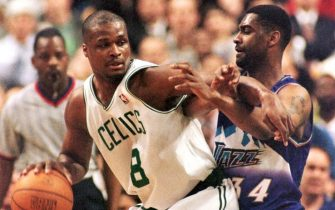 BOSTON, UNITED STATES:  Utah Jazz (#34) Chris Morris (R) defends against a drive by Boston Celtics Antoine Walker in the first half of action 04 March at the Fleet Center in Boston, MA.                                                   AFP PHOTO JOHN MOTTERN (Photo credit should read JOHN MOTTERN/AFP via Getty Images)