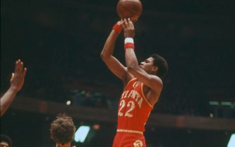 PHILADELPHIA, PA - CIRCA 1976: John Drew #22 of the Atlanta Hawks shoots over Doug Collins #20 of the Philadelphia 76ers during an NBA basketball game circa 1976 at The Spectrum in Philadelphia, Pennsylvania. Drew played for the Hawks from 1974-82. (Photo by Focus on Sport/Getty Images)