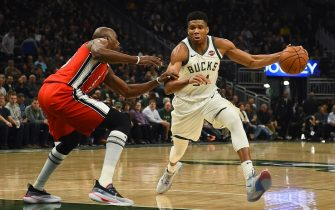 MILWAUKEE, WISCONSIN - NOVEMBER 21: Giannis Antetokounmpo #34 of the Milwaukee Bucks drives around Anthony Tolliver #43 of the Portland Trail Blazers during the second half of a game at Fiserv Forum on November 21, 2019 in Milwaukee, Wisconsin. NOTE TO USER: User expressly acknowledges and agrees that, by downloading and or using this photograph, User is consenting to the terms and conditions of the Getty Images License Agreement. (Photo by Stacy Revere/Getty Images)