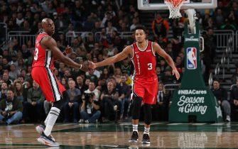 CHICAGO, IL - NOVEMBER 21: Anthony Tolliver #43 and CJ McCollum #3 of the Portland Trail Blazers hi-five during a game against the Milwaukee Bucks on November 21, 2019 at the United Center in Chicago, Illinois. NOTE TO USER: User expressly acknowledges and agrees that, by downloading and or using this photograph, user is consenting to the terms and conditions of the Getty Images License Agreement.  Mandatory Copyright Notice: Copyright 2019 NBAE (Photo by Gary Dineen/NBAE via Getty Images)