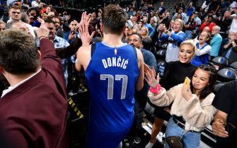 DALLAS, TX - NOVEMBER 18: Luka Doncic #77 of the Dallas Mavericks high-fives fans after a game against the San Antonio Spurs on November 18, 2019 at the American Airlines Center in Dallas, Texas. NOTE TO USER: User expressly acknowledges and agrees that, by downloading and or using this photograph, User is consenting to the terms and conditions of the Getty Images License Agreement. Mandatory Copyright Notice: Copyright 2019 NBAE (Photo by Glenn James/NBAE via Getty Images)