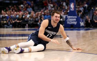 DALLAS, TEXAS - NOVEMBER 20:  Luka Doncic #77 of the Dallas Mavericks after a foul by Glenn Robinson III #22 of the Golden State Warriors in the first half at American Airlines Center on November 20, 2019 in Dallas, Texas.  NOTE TO USER: User expressly acknowledges and agrees that, by downloading and or using this photograph, User is consenting to the terms and conditions of the Getty Images License Agreement.  (Photo by Ronald Martinez/Getty Images)