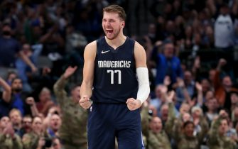 DALLAS, TEXAS - NOVEMBER 06: Luka Doncic #77 of the Dallas Mavericks celebrates after the Dallas Mavericks scored against the Orlando Magic in the second half at American Airlines Center on November 06, 2019 in Dallas, Texas. NOTE TO USER: User expressly acknowledges and agrees that, by downloading and or using this photograph, User is consenting to the terms and conditions of the Getty Images License Agreement. (Photo by Tom Pennington/Getty Images)