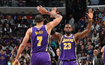 MEMPHIS, TN - NOVEMBER 23: JaVale McGee #7 and LeBron James #23 of the Los Angeles Lakers hi-five during a game against the Memphis Grizzlies on November 23, 2019 at FedExForum in Memphis, Tennessee. NOTE TO USER: User expressly acknowledges and agrees that, by downloading and or using this photograph, User is consenting to the terms and conditions of the Getty Images License Agreement. Mandatory Copyright Notice: Copyright 2019 NBAE (Photo by Joe Murphy/NBAE via Getty Images)
