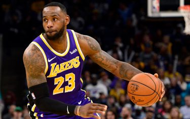 MEMPHIS, TN - NOVEMBER 23: LeBron James #23 of the Los Angeles Lakers handles the ball during a game against the Memphis Grizzlies at FedExForum on November 23, 2019 in Memphis, Tennessee. NOTE TO USER: User expressly acknowledges and agrees that, by downloading and/or using this photograph, user is consenting to the terms and conditions of the Getty Images License Agreement. (Photo by Brandon Dill/Getty Images)