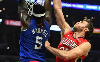 LOS ANGELES, CA - NOVEMBER 24:  Montrezl Harrell #5 of the Los Angeles Clippers dunks over Nicolo Melli #20 of the New Orleans Pelicans in the second half of the game against the New Orleans Pelicans at Staples Center on November 24, 2019 in Los Angeles, California.  NOTE TO USER: User expressly acknowledges and agrees that, by downloading and/or using this Photograph, user is consenting to the terms and conditions of the Getty Images License Agreement. (Photo by Jayne Kamin-Oncea/Getty Images)