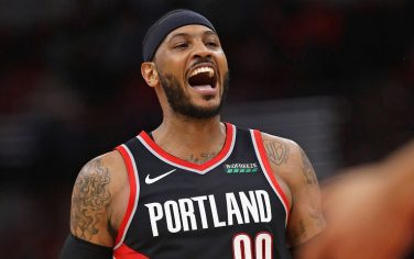 CHICAGO, ILLINOIS - NOVEMBER 25: Carmelo Anthony #00 of the Portland Trail Blazers yells after a dunk against the Chicago Bulls at the United Center on November 25, 2019 in Chicago, Illinois. The Trailblazers defeated the Bulls 117-94. NOTE TO USER: User expressly acknowledges and agrees that, by downloading and or using this photograph, User is consenting to the terms and conditions of the Getty Images License Agreement. (Photo by Jonathan Daniel/Getty Images)