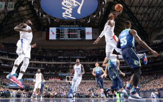DALLAS, TX - NOVEMBER 26: Paul George #13 of the LA Clippers dunks the ball against the Dallas Mavericks on November 26, 2019 at the American Airlines Center in Dallas, Texas. NOTE TO USER: User expressly acknowledges and agrees that, by downloading and or using this photograph, User is consenting to the terms and conditions of the Getty Images License Agreement. Mandatory Copyright Notice: Copyright 2019 NBAE (Photo by Glenn James/NBAE via Getty Images)
