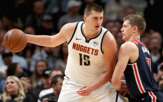 DENVER, COLORADO - NOVEMBER 26: Nikola Jokic #15 of the Denver Nuggets drives against Moritz Wagner #21 of the Washington Wizards in the first quarter at the Pepsi Center on November 26, 2019 in Denver, Colorado. NOTE TO USER: User expressly acknowledges and agrees that, by downloading and or using this photograph, User is consenting to the terms and conditions of the Getty Images License Agreement.  (Photo by Matthew Stockman/Getty Images)