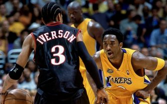 LOS ANGELES - 2001:  Kobe Bryant #8 of the Los Angeles Lakers digs in on defense against Allen Iverson #3 of the Philadelphia 76ers during a 2001 NBA game at the Staples Center in Los Angeles, California. NOTE TO USER: User expressly acknowledges that, by downloading and or using this photograph, User is consenting to the terms and conditions of the Getty Images License agreement. Mandatory Copyright Notice: Copyright 2001 NBAE (Photo by Andrew D. Bernstein/NBAE via Getty Images)