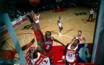 ATLANTA - 1986: Moses Malone #2 of the Philadelphia 76'ers drives to the basket for a layup against the Atlanta Hawks during the NBA game in Atlanta, Georgia. NOTE TO USER: User expressly acknowledges  and agrees that, by downloading and or using this  photograph, User is consenting to the terms and conditions of the Getty Images License Agreement. (Photo by Scott Cunningham/ NBAE/ Getty Images)