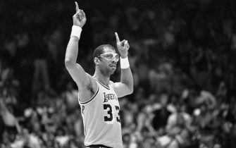 (Original Caption) 6/2/1985-Inglewood, CA- Lakers', Kareem Abdul-Jabbar, acknowledges the cheering crowd during the NBA Championship game against the Celtics, when it was announced that he had become the all-time playoff scoring leader. Ph: Alan Zanger