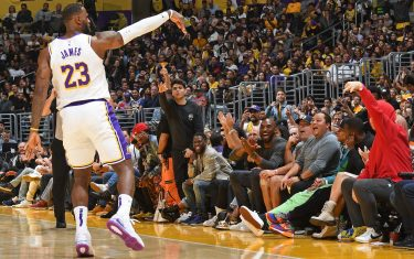 LOS ANGELES, CA - NOVEMBER 17: LeBron James #23 of the Los Angeles Lakers celebrates a three point basket with the fans and Kobe Bryant during the game against the Atlanta Hawks on November 17, 2019 at STAPLES Center in Los Angeles, California. NOTE TO USER: User expressly acknowledges and agrees that, by downloading and/or using this Photograph, user is consenting to the terms and conditions of the Getty Images License Agreement. Mandatory Copyright Notice: Copyright 2019 NBAE (Photo by Andrew D. Bernstein/NBAE via Getty Images)