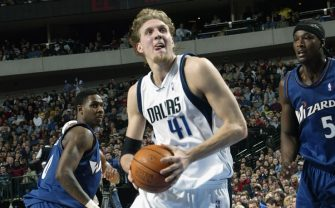 DALLAS - DECEMBER 23:  Dirk Nowitzki #41 of the Dallas Mavericks drives to the basket during the NBA game against the Washington Wizards at American Airlines Center on December 23, 2002 in Dallas, Texas.  The Mavericks won 92-86.  NOTE TO USER:  User expressly acknowledges and agrees that, by downloading and or using this Photograph, User is consenting to the terms and conditions of the Getty Images License Agreement.  Mandatory copyright notice:  Copyright 2002 NBAE.  (Photo by: Layne Murdoch/NBAE via Getty Images)