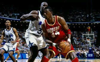 ORLANDO, FL - JUNE 9:  Hakeem Olajuwon #34 of the Houston Rockets makes a move against Shaquille O'Neal #34 of the Orlando Magic in Game Two of the 1995 NBA Finals at the Orlando Arena on June 9, 1995 in Orlando, Florida.  The Rockets won 117-106.  NOTE TO USER: User expressly acknowledges that, by downloading and or using this photograph, User is consenting to the terms and conditions of the Getty Images License agreement. Mandatory Copyright Notice: Copyright 1995 NBAE (Photo by Nathaniel S. Butler/NBAE via Getty Images)
