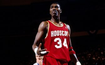 NEW YORK - JUNE 12:  Hakeem Olajuwon #34 of the Houston Rockes reacts against the New York Knicks during Game Three of the NBA Finals played on June 12, 1994 at Madison Square Garden in New York, New York.  NOTE TO USER: User expressly acknowledges that, by downloading and or using this photograph, User is consenting to the terms and conditions of the Getty Images License agreement. Mandatory Copyright Notice: Copyright 1994 NBAE (Photo by Nathaniel S. Butler/NBAE via Getty Images)