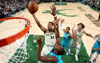 MILWAUKEE, WI - NOVEMBER 30: Giannis Antetokounmpo #34 of the Milwaukee Bucks drives to the basket during a game against the Charlotte Hornets on November 30, 2019 at the Fiserv Forum Center in Milwaukee, Wisconsin. NOTE TO USER: User expressly acknowledges and agrees that, by downloading and or using this Photograph, user is consenting to the terms and conditions of the Getty Images License Agreement. Mandatory Copyright Notice: Copyright 2019 NBAE (Photo by Gary Dineen/NBAE via Getty Images).