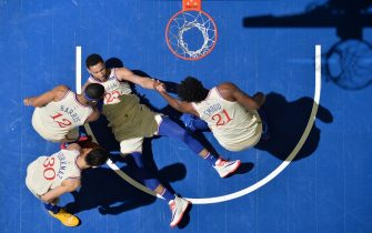 PHILADELPHIA, PA - NOVEMBER 30: Ben Simmons #25 of the Philadelphia 76ers is helped up by his teammates during the game against the Indiana Pacers on November 30, 2019 at the Wells Fargo Center in Philadelphia, Pennsylvania NOTE TO USER: User expressly acknowledges and agrees that, by downloading and/or using this Photograph, user is consenting to the terms and conditions of the Getty Images License Agreement. Mandatory Copyright Notice: Copyright 2019 NBAE (Photo by Jesse D. Garrabrant/NBAE via Getty Images)