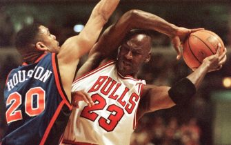 Chicago Bulls' guard Michael Jordan (23) keeps the ball away from New York Knicks' Allan Houston during the first half of their game at the United Center in Chicago 18 April.  AFP PHOTO/Daniel LIPPITT (Photo by DANIEL LIPPITT / AFP) (Photo by DANIEL LIPPITT/AFP via Getty Images)