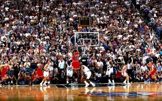SALT LAKE CITY - JUNE 14:  Michael Jordan #23 of the Chicago Bulls shoots the game-winning jumpshot over Byron Russell #3 of the Utah Jazz during Game Six of the 1998 NBA Finals on June 14, 1998 at the Delta Center in Salt Lake City, Utah. The Bulls defeated the Jazz 87-86.  NOTE TO USER: User expressly acknowledges and agrees that, by downloading and or using this Photograph, user is consenting to the terms and conditions of the Getty Images License Agreement.  Mandatory Copyright Notice: Copyright 1998 NBAE (Photo by Fernando Medina/NBAE via Getty Images)