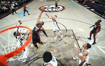 BROOKLYN, NY - DECEMBER 1: Bam Adebayo #13 of the Miami Heat grabs the rebound against the Miami Heat on December 1, 2019 at Barclays Center in Brooklyn, New York. NOTE TO USER: User expressly acknowledges and agrees that, by downloading and or using this Photograph, user is consenting to the terms and conditions of the Getty Images License Agreement. Mandatory Copyright Notice: Copyright 2019 NBAE (Photo by Nathaniel S. Butler/NBAE via Getty Images)