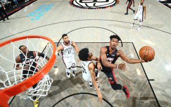 BROOKLYN, NY - DECEMBER 1: Jimmy Butler #22 of the Miami Heat drives to the basket against the Brooklyn Nets on December 1, 2019 at Barclays Center in Brooklyn, New York. NOTE TO USER: User expressly acknowledges and agrees that, by downloading and or using this Photograph, user is consenting to the terms and conditions of the Getty Images License Agreement. Mandatory Copyright Notice: Copyright 2019 NBAE (Photo by Nathaniel S. Butler/NBAE via Getty Images)