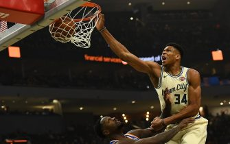 MILWAUKEE, WISCONSIN - DECEMBER 02:  Giannis Antetokounmpo #34 of the Milwaukee Bucks dunks over Julius Randle #30 of the New York Knicks during the first half at Fiserv Forum on December 02, 2019 in Milwaukee, Wisconsin. NOTE TO USER: User expressly acknowledges and agrees that, by downloading and or using this photograph, User is consenting to the terms and conditions of the Getty Images License Agreement.  (Photo by Stacy Revere/Getty Images)