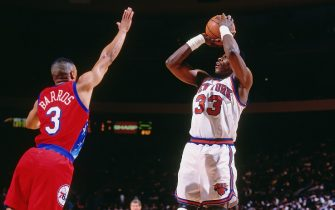 NEW YORK CITY - 1994:   Patrick Ewing #33 of the New York Knicks shoots the ball against the Philadelphia 76ers circa 1994 at Madison Square Garden in New York City. NOTE TO USER: User expressly acknowledges and agrees that, by downloading and or using this photograph, User is consenting to the terms and conditions of the Getty Images License Agreement. Mandatory Copyright Notice: Copyright 1994 NBAE (Photo by Nathaniel S. Butler/NBAE via Getty Images)