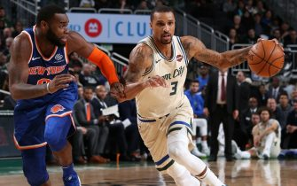 MILWAUKEE, WI - DECEMBER 2: George Hill #3 of the Milwaukee Bucks handles the ball against the New York Knicks on December 2, 2019 at the Fiserv Forum Center in Milwaukee, Wisconsin. NOTE TO USER: User expressly acknowledges and agrees that, by downloading and or using this Photograph, user is consenting to the terms and conditions of the Getty Images License Agreement. Mandatory Copyright Notice: Copyright 2019 NBAE (Photo by Gary Dineen/NBAE via Getty Images).