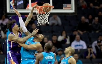 CHARLOTTE, NORTH CAROLINA - DECEMBER 02: Kelly Oubre Jr. #3 of the Phoenix Suns dunks the ball over Miles Bridges #0 of the Charlotte Hornets during their game at Spectrum Center on December 02, 2019 in Charlotte, North Carolina. NOTE TO USER: User expressly acknowledges and agrees that, by downloading and or using this photograph, User is consenting to the terms and conditions of the Getty Images License Agreement. (Photo by Streeter Lecka/Getty Images)