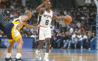 SAN ANTONIO, TX - CIRCA 1992:  Avery Johnson #6 of the San Antonio Spurs dribbles the ball against the Indiana Pacers during an NBA basketball game circa 1992 at the HemisFair Arena in San Antonio, Texas. Johnson played for the Spurs in 1991, 1992-93 and 1994-2001. (Photo by Focus on Sport/Getty Images)