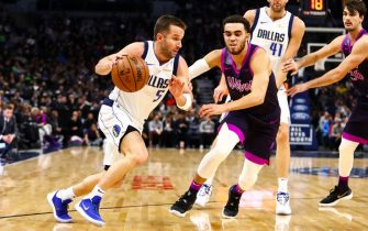 MINNEAPOLIS, MN - JANUARY 11: J.J. Barea #5 of the Dallas Mavericks dribbles while Tyus Jones #1 of the Minnesota Timberwolves defends in the second quarter at Target Center on January 11, 2019 in Minneapolis, Minnesota. The Dallas Mavericks defeated the Minnesota Timberwolves 119-115. NOTE TO USER: User expressly acknowledges and agrees that, by downloading and or using this Photograph, user is consenting to the terms and conditions of the Getty Images License Agreement. (Photo by David Berding/Getty Images)