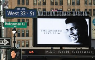 NEW YORK, NY - JUNE 9: 'Muhammad Ali Way,' a temporary street sign in honor of the late boxer, is displayed on the corner of West 33rd Street and Seventh Avenue near Madison Square Garden, June 9, 2016 in New York City. New York City Mayor Bill de Blasio announced on Tuesday that West 33rd Street adjacent to Madison Square Garden will be temporarily renamed for the late boxer Muhammad Ali, whose funeral will be held Friday in Ali's hometown of Louisville, Kentucky. (Photo by Drew Angerer/Getty Images)