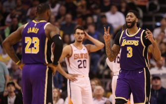 PHOENIX, ARIZONA - NOVEMBER 12: Anthony Davis #3 and LeBron James #23 of the Los Angeles Lakers talk during the second half of the NBA game against the Phoenix Suns at Talking Stick Resort Arena on November 12, 2019 in Phoenix, Arizona. The Lakers defeated the Suns 123-115. NOTE TO USER: User expressly acknowledges and agrees that, by downloading and/or using this photograph, user is consenting to the terms and conditions of the Getty Images License Agreement  (Photo by Christian Petersen/Getty Images)
