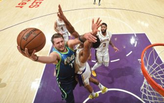 LOS ANGELES, CA - DECEMBER 1: Luka Doncic #77 of the Dallas Mavericks drives to the basket against the Los Angeles Lakers on December 1, 2019 at STAPLES Center in Los Angeles, California. NOTE TO USER: User expressly acknowledges and agrees that, by downloading and/or using this Photograph, user is consenting to the terms and conditions of the Getty Images License Agreement. Mandatory Copyright Notice: Copyright 2019 NBAE (Photo by Andrew D. Bernstein/NBAE via Getty Images)