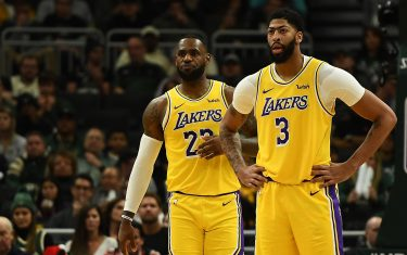 MILWAUKEE, WISCONSIN - DECEMBER 19:  LeBron James #23 and Anthony Davis #3 of the Los Angeles Lakers wait for a free throw during the second half of a game against the Milwaukee Bucks at Fiserv Forum on December 19, 2019 in Milwaukee, Wisconsin. NOTE TO USER: User expressly acknowledges and agrees that, by downloading and or using this photograph, User is consenting to the terms and conditions of the Getty Images License Agreement. (Photo by Stacy Revere/Getty Images)