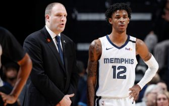 MEMPHIS, TN - JANUARY 28: Ja Morant #12 of the Memphis Grizzlies talks to head coach Taylor Jenkins during a game against the Denver Nuggets at FedExForum on January 28, 2020 in Memphis, Tennessee. Memphis defeated Denver 104-96. NOTE TO USER: User expressly acknowledges and agrees that, by downloading and or using this Photograph, user is consenting to the terms and conditions of the Getty Images License Agreement. (Photo by Joe Robbins/Getty Images)