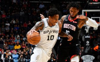 SAN ANTONIO, TX - DECEMBER 3: DeMar DeRozan #10 of the San Antonio Spurs handles the ball against the Houston Rockets on December 3, 2019 at the AT&T Center in San Antonio, Texas. NOTE TO USER: User expressly acknowledges and agrees that, by downloading and or using this photograph, user is consenting to the terms and conditions of the Getty Images License Agreement. Mandatory Copyright Notice: Copyright 2019 NBAE (Photos by Logan Riely/NBAE via Getty Images)