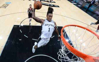 SAN ANTONIO, TX - DECEMBER 3: Lonnie Walker IV #1 of the San Antonio Spurs dunks the ball against the Houston Rockets on December 3, 2019 at the AT&T Center in San Antonio, Texas. NOTE TO USER: User expressly acknowledges and agrees that, by downloading and or using this photograph, user is consenting to the terms and conditions of the Getty Images License Agreement. Mandatory Copyright Notice: Copyright 2019 NBAE (Photos by Logan Riely/NBAE via Getty Images)